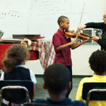 DONATE AN INSTRUMENT Photo credit Kimberley Warner - Omarion gets a viola lesson Credit: Photo courtesy Kimberly Warner BRAVO welcomes gifts of student-sized instruments in good condition. Please contact us for a list of current needs.